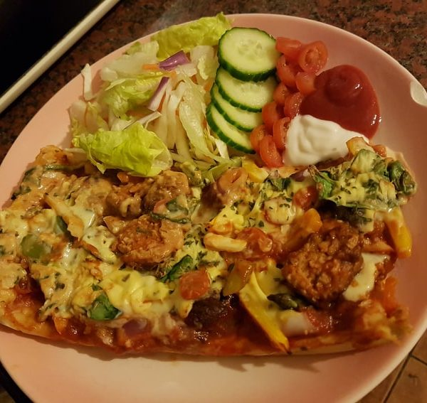 Thin crust homemade pizza and salad