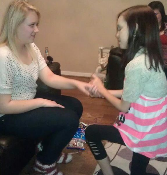 Lucy pretending to propose to our friend Vic