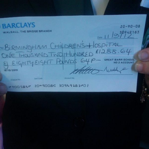 The cheque from the money we raised for the Birmingham Childrens Hospital